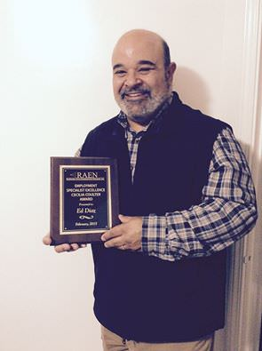 Ed Diaz holding his RAEN Award, March 2015