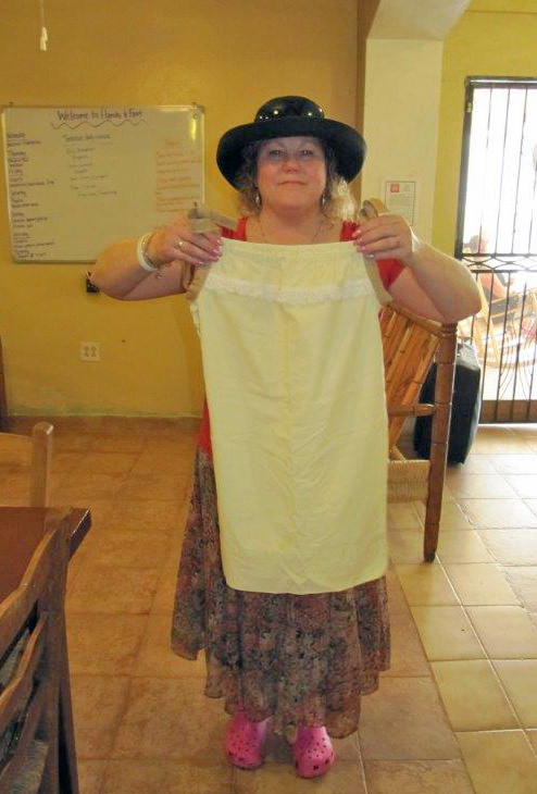 Garvey displays a pillowcase dress which was donated by a volunteer at Glenwell for her trip to Haiti.