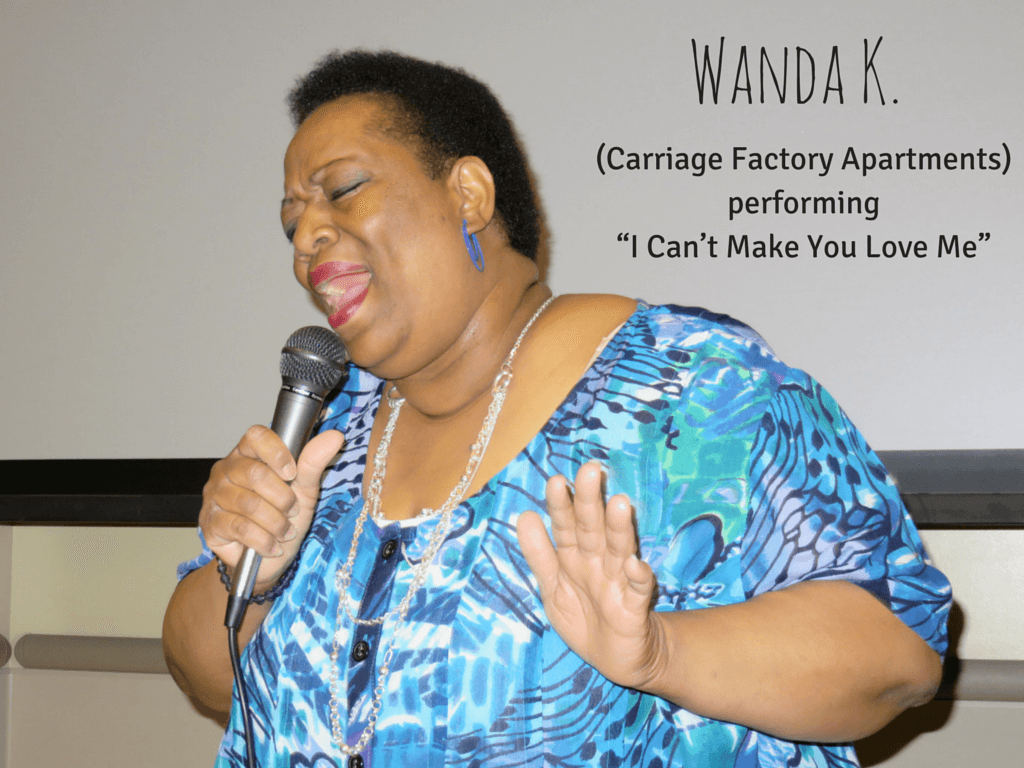"Wanda K. from Carriage Factory Apartments singing ""I Can't Make You Love Me"""