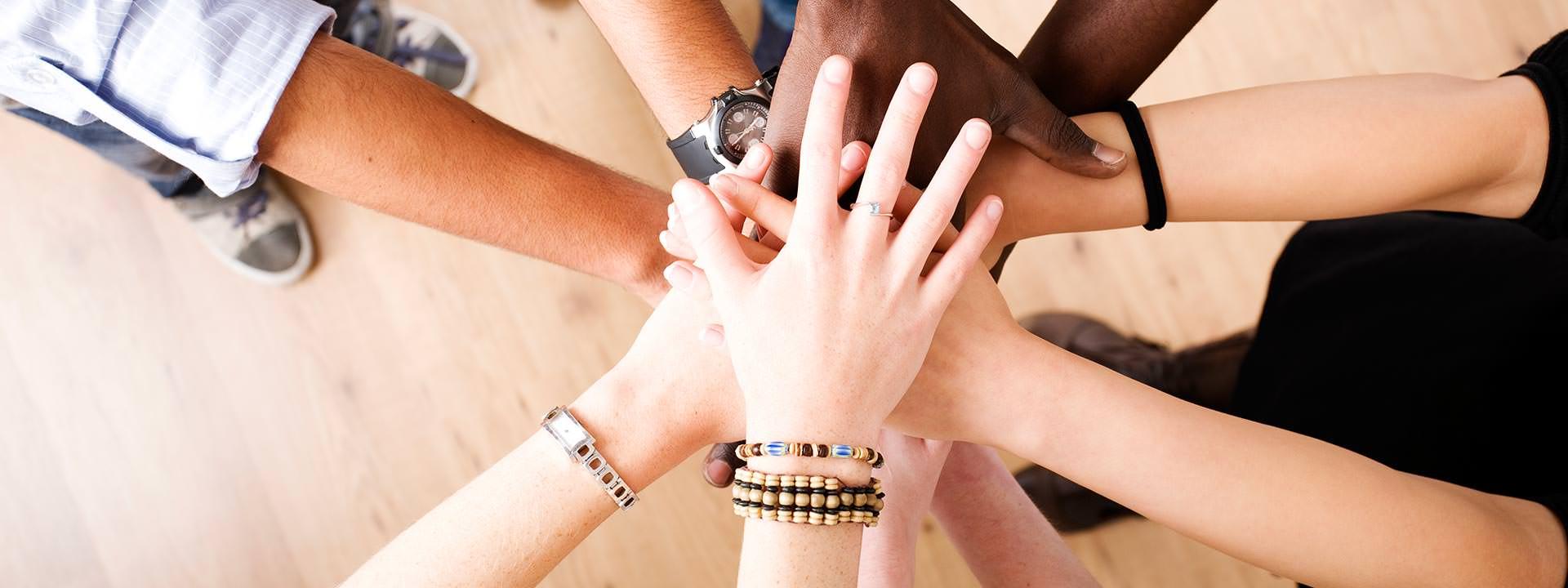 DePaul Employment Banner Diverse Employee Hands In