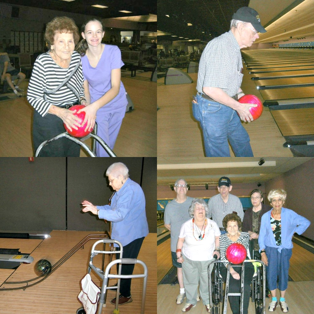 Residents bowling at a bowling alley