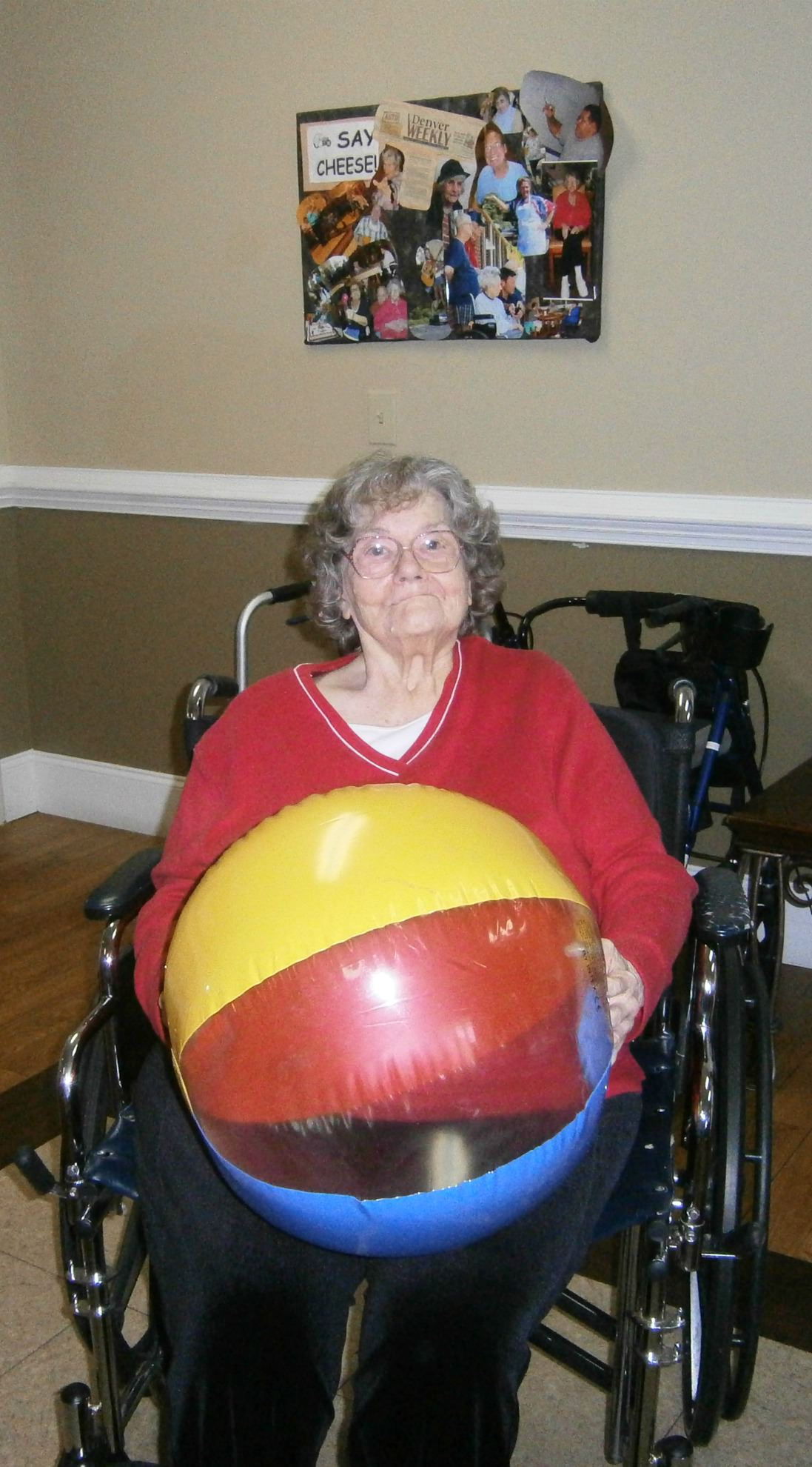 Resident holding a beach ball during exercise