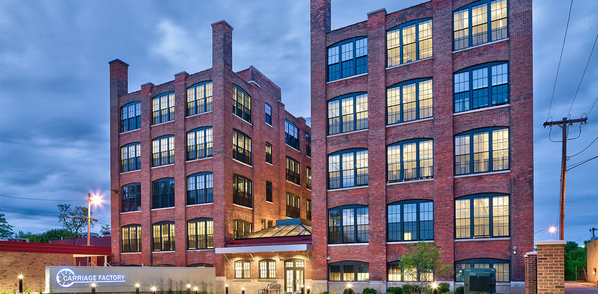 Carriage Factory Apartments Exterior at Dusk