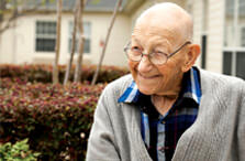 Smiling elderly man outdoors