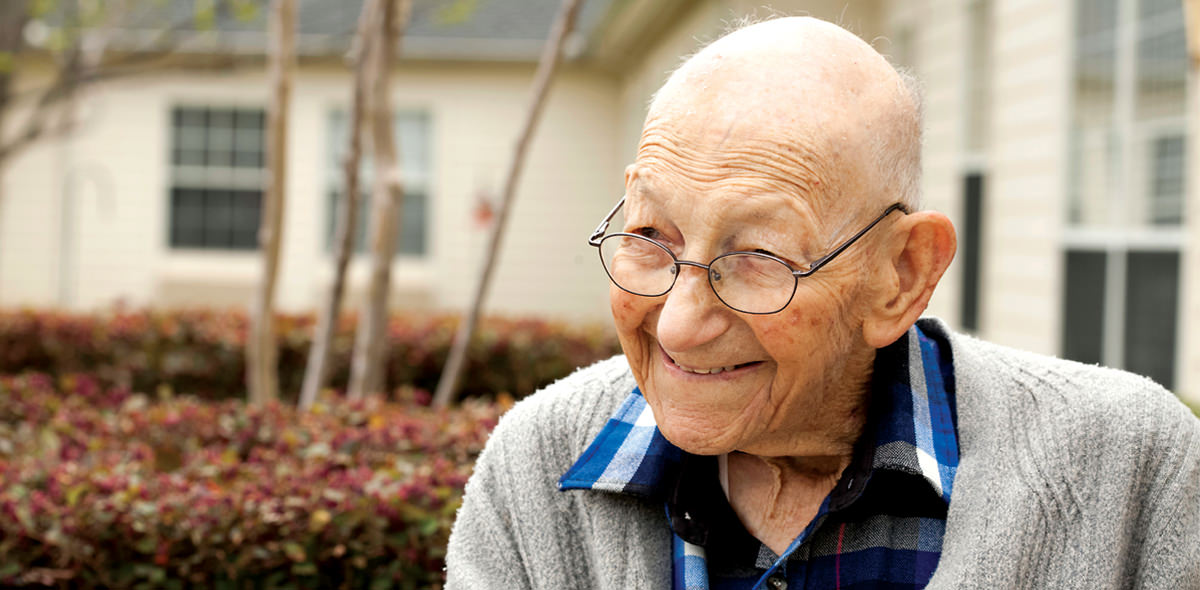 Smiling Elderly Man with Glasses Outdoors