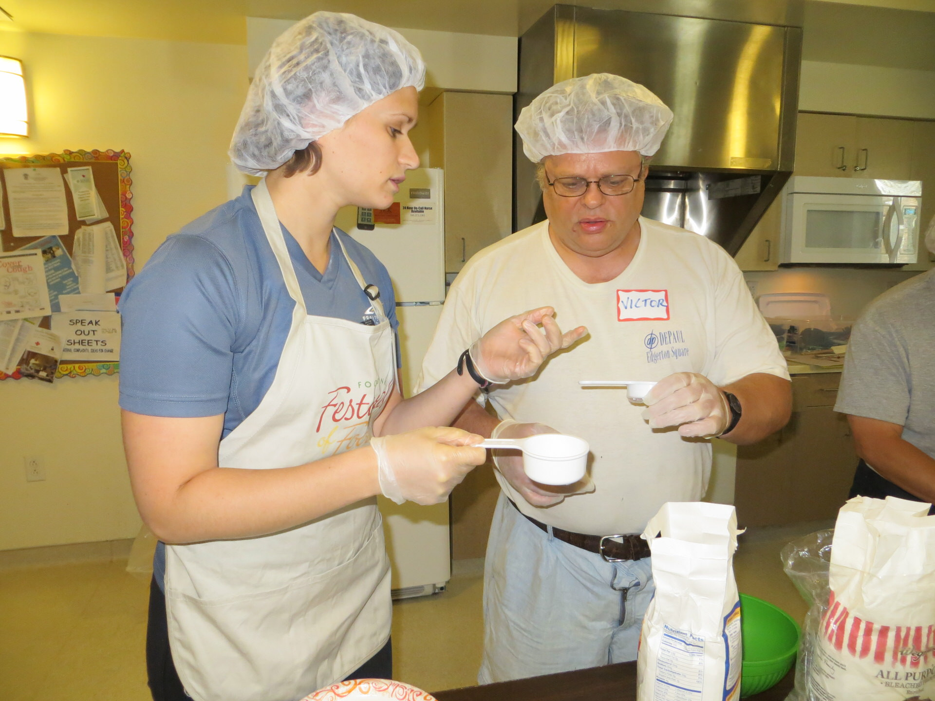 April Miller of Foodlink works with resident Victor W. in the kitchen at Ridgeview Commons.