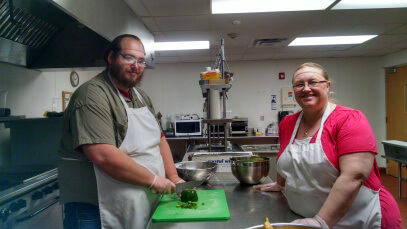 PROS client Thomas B. works with Dietary Director and Office Manager Pam Maglier on a cooking lesson