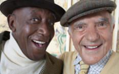 African american and white elderly men smiling