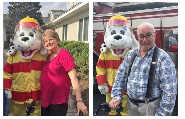 Monroe Fire Department's mascot Sparky are Woodridge residents Libby Hess and Eddie Craig