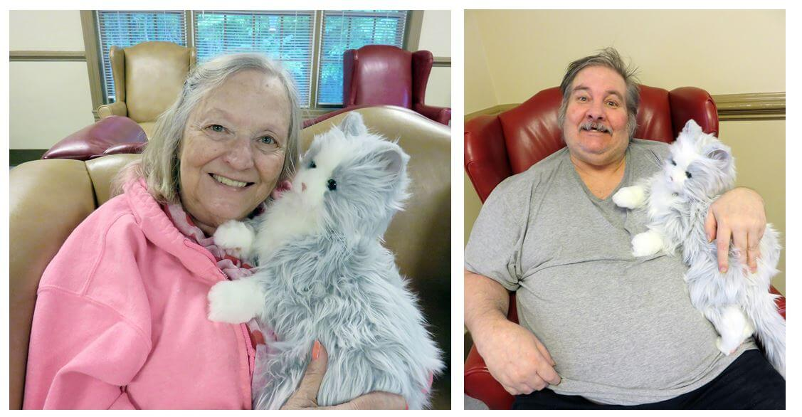 Twelve Oaks residents holding and cuddling with the Hasbro Joy for All companion cat