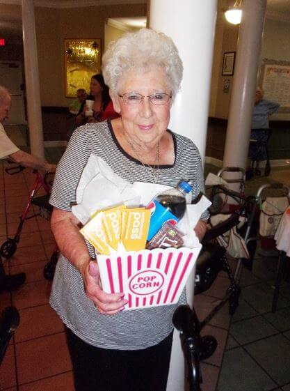 A resident with their winning movie themed raffle basket