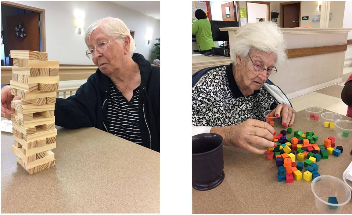 Residents playing Jenga and sorting colored cubes
