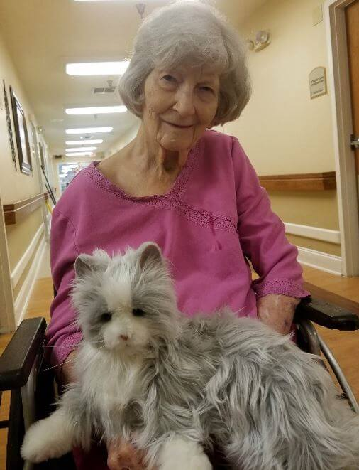 A resident of Rolling Ridge holding the comfort companion cat