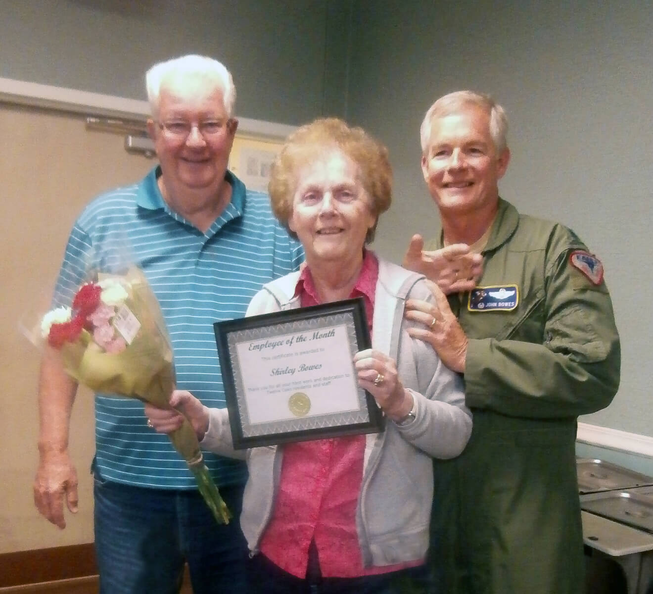 Shirley Barnes, a resident of Twelve Oaks with her husband and son after winning employee of the month