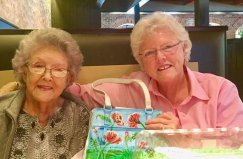 Dayspring Of Wallace Daisy's holding painted purses