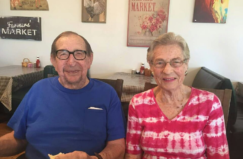 elderly couple sitting next to each other
