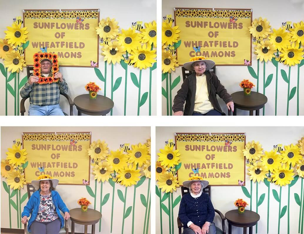 Four Wheatfield Commons Residents With Sunflowers Display