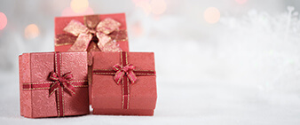 Three red gift boxes on a blurry background