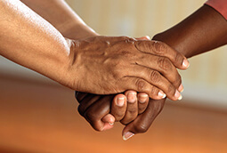 Staff Support For Residents Clasped Hands